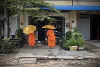 Two Buddhist monks at a local shop in Kampot, Cambodia.