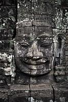 Stone carved Buddha head in Bayon at the Angkor Thom temple in Angkor Wat, Siem Reap, Cambodia.