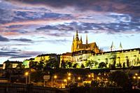 Night falls at Hradcany Castle in Prague, Czech Republic.