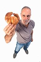 man with croissant on white background.