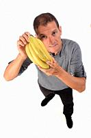 man with banana on white background.