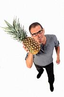 man with pineapple on white background.