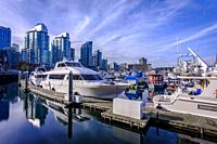 Some tiny house boats in Coal Harbour , Vancouver, British Columbia during a wonderful sunny afternoon in November.