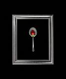 Still life with Strawberry on a spoon in the frame.