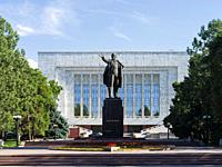 The Lenin monument at the National Museum. The capital Bishkek located in the foothills of Tien Shan. Asia, Central Asia, Kyrgyzstan.