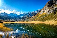 Panoramic view of the alpine Seebersee lake with the high rising mountains of the Texelgruppe in the background near the Timmelsjoch alpine street in ...