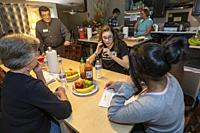 Aurora, Colorado - Volunteers at Casa de Paz help immigrants released from an immigrant detention center. Casa de Paz provides meals, a bed, clothing ...