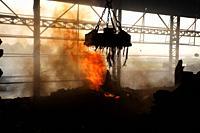 Scrap steel melts down in an induction furnace at Demra, Dhaka, Bangladesh.