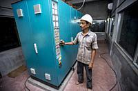 A Steel Mill factory operator using machine at Demra, Dhaka, Bangladesh.