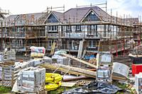 Houses under construction at a building site run by Stewart Milne, Troon, Ayrshire, Scotland, UK.