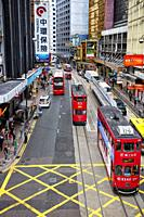 Double-decker trams on Des Voeux Road Central. Central, Hong Kong, China.