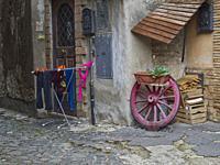 wagon wheel and hanging laundry, Tivoli, Lazio, Italy.