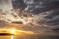Sunset on beach in Whitepark Bay County Antrim Northern Ireland.