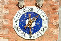 Clock at the Entrance tower of the historic Venetian Arsenal and Naval Museum in Castello district of Venice - Italy.