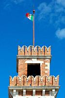 Tower of the historic Venetian Arsenal and Naval Museum in Castello district of Venice with Italian flag - Italy.