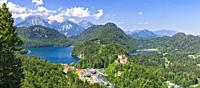 View from Jugend lookout point towards Schloss Hohenschwangau Castle and the Alpsee and Schwansee Lakes, Hohenschwangau, Schwangau, Bavaria, Germany.