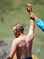 Portrait of a competitor. Er Enish or Oodarysh, wrestling from horseback, a traditional equestrian sport. Folk and Sport festival on the Suusamyr plai...