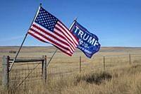 """Wright, Wyoming - A """"""""Trump 2020"""""""" flag with an American flag on a Wyoming ranch."""