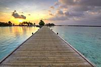 Footbridge of Paradise Island (Lankanfinolhu) at sunset, Maldives.