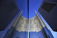 Unicredit tower reflected in a window, Porta Nuova, Milan, Italy.