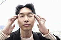 Korean man concentrating