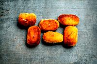 Croquettes on artistic background