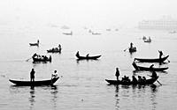 "Bangladesh â. "" January 06, 2014: In the midday afternoon, people are crossing the river by boat and this year the fog of the winter is engulfed in th..."