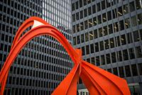 Flamingo sculpture by Alexander Calder, is a stabile located in the Federal Plaza in front of the Kluczynski Federal Building, Chicago, Illinois, USA.
