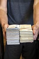 Man holds wads of cash. Bulgarian currency, Bulgarian lev.
