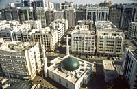 Downtown Abu Dhabi seen from above Hamdan Street, UAE, 1984-85. The green-roofed building is a small mosque.