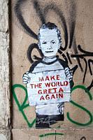 Make The World Greta Again , Sign on wall in LIsbon, Portugal.