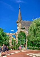"Ravadinovo, Bulgaria â. "" 07. 11. 2019. Arched gate in the park of Ravadinovo castle, Bulgaria, on a summer sunny day."