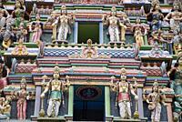 Tower (gopuram) with gaudy deities, Sri Srinivasa Perumal Temple, Little India, Singapore.
