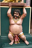 Statue of strong man with gaudy decoration, Sri Vadapathira Kaliamman Temple, Little India, Singapore.