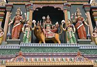 Tower (gopuram) with gaudy deities, Sri Vadapathira Kaliamman Temple, Little India, Singapore.