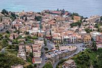 Old Town of Taormina city seen from Castelmola town in the Province of Messina in the Italian region Sicily.
