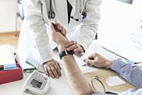 Doctor examine patients pulse.