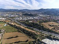 Aerial view of AP-7 highway and industrial area. Parets del Vallès. Barcelona, Spain.