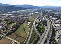 Aerial view of AP-7 highway and industrial area. Montmelós. Barcelona, Spain.