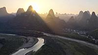 Aerial view of Xingping karsts hills and Li river at sunset near Yangshuo in Guanxi province, China.