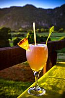 Coctail at sunset in tropical nature of Vinales, Republic of Cuba, Caribbean, Central America.