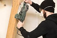 handyman works with detail sander , renovating a home building concept.