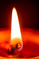 extreme closeup of fire burning in a butterlamp. selective focus.