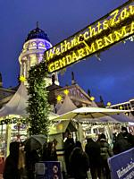 Berlin, Germany, Tourists Visiting Christmas Market, in CIty Center at Night, Gendarmenmark, German Cathedral.