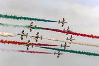 """LINATE MILAN, ITALY October 12 2019 - military jets of Italian Aerobatic Military team """"""""PAN"""""""" come across with tricolor smoke at airshow, shot in fal..."""