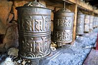 Prayer wheels at Kag Chode Thupten Samphel Ling Monastery in Kagbeni village, Mustang district, Nepal.