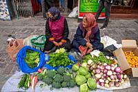 women selling vegetables at streetmarket in Leh, Ladakh, India