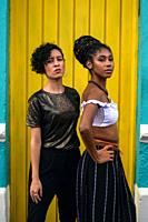 Two latin young women in the streets of Cali, Colombia.