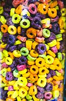 Cereal in many colours in a vertical column