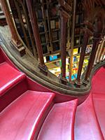 Stairs and bookshelf of Lello Bookstore in Porto, Portugal.
